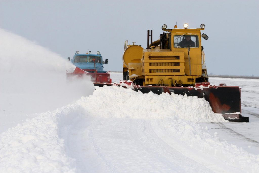 man plowing out the snow
