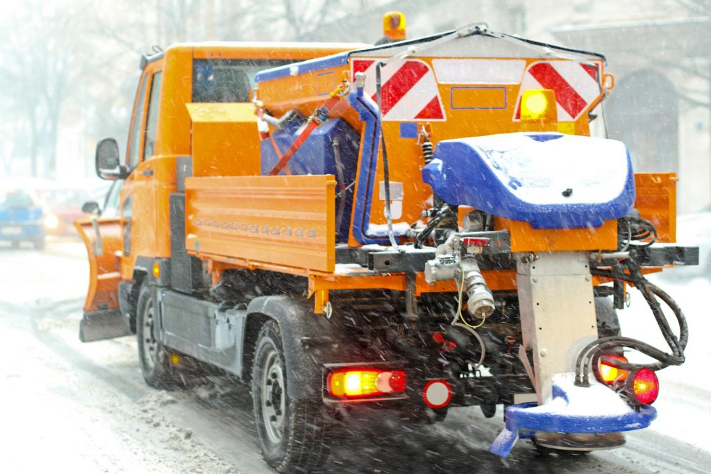 truck plowing the snow